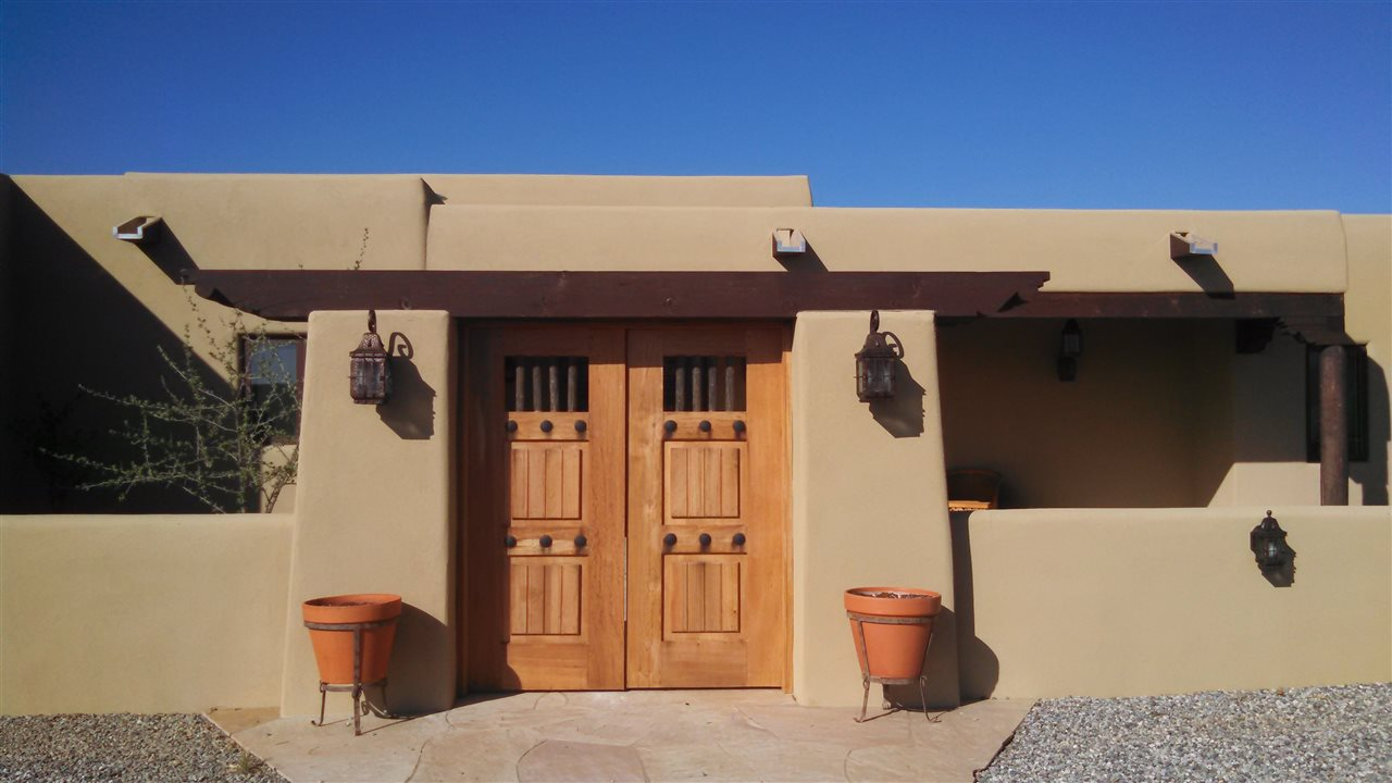 Cindy sheff turquoise trail real estate homes land in santa fe new mexico horse properties in - The rammed earth hacienda ...